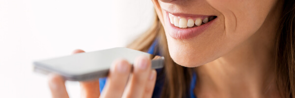 woman using voice recorder on smartphone