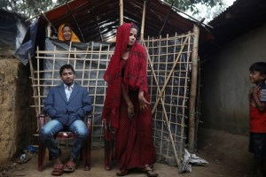 Rohingya refugees Saddam Hussein, 23, and his wife Shofika Begum, 18, pose for a photo in front of their temporary shelter at the Kutupalong refugee camp near Cox's Bazar, Bangladesh. Credit: Reuters/Marko Djurica