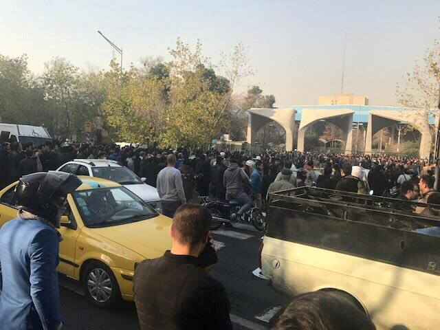 People protest near the university of Tehran, Iran December 30, 2017 in this picture obtained from social media. Credit: Reuters