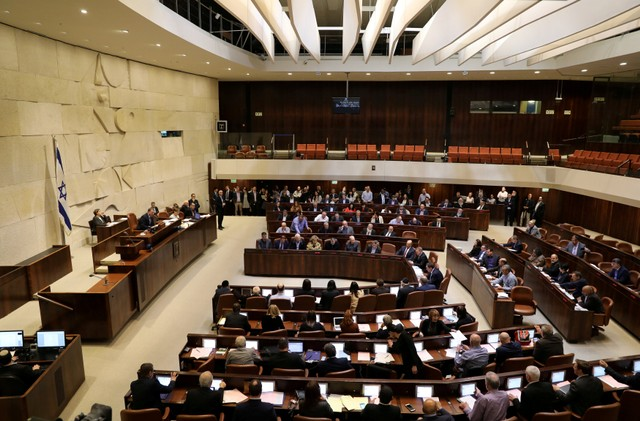 FILE PHOTO: Israeli lawmakers attend a vote on a bill at the Knesset, the Israeli parliament, in Jerusalem February 6, 2017. Credit: Reuters/Ammar Awad/File Photo
