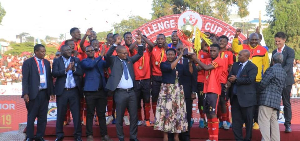 Uganda Cranes players and officials celebrating with the trophy