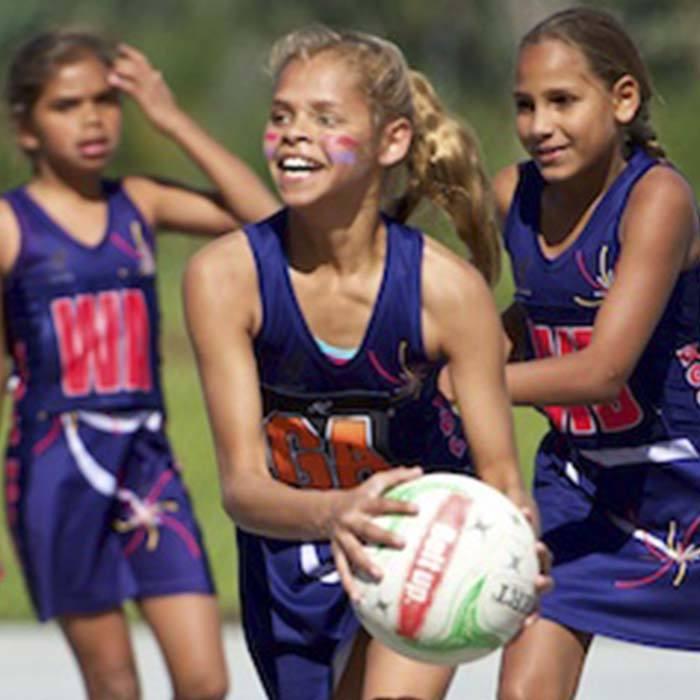 Indigenous girls playing netball. onenetball.org.au