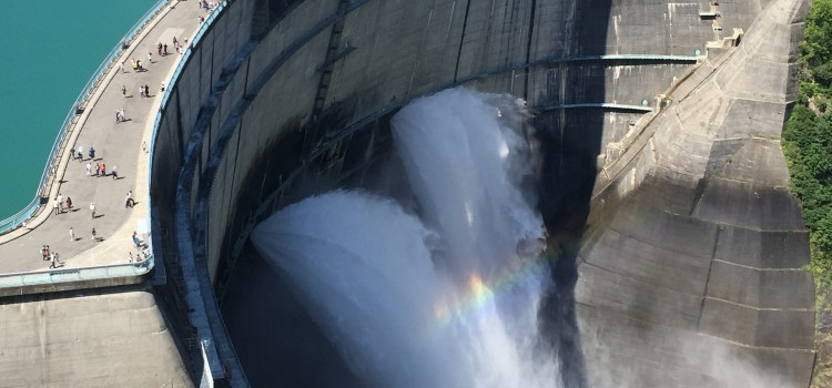 An aerial view of water flowing through a dam.