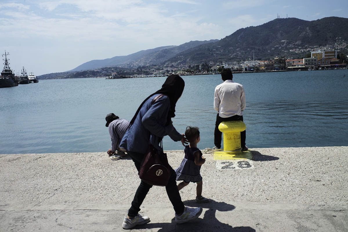 afghan-family-refugees-fishing-mitilini-port-med-land-project