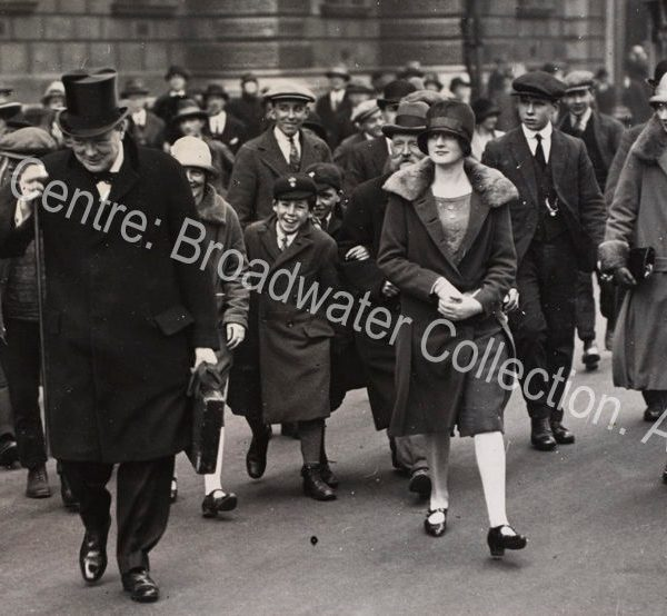 Photo shows WSC walking in a crowd of people