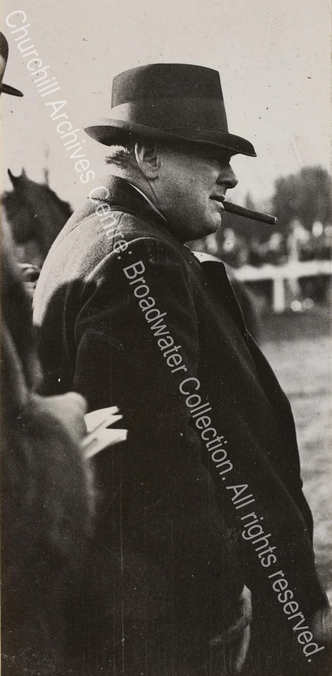 Photo shows WSC in profile with a hat pulled down over his eyes and a cigar in his mouth.