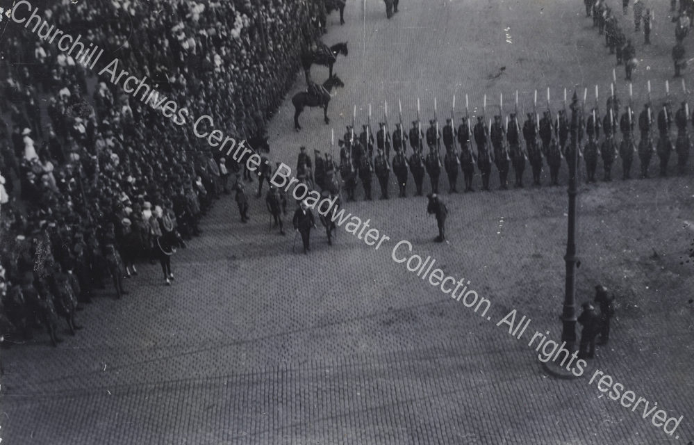 Aerial photograph [? taken by someone in the cathedral] of WSC [Secretary of State for War] inspecting troops.  WSC is in the centre of the photograph