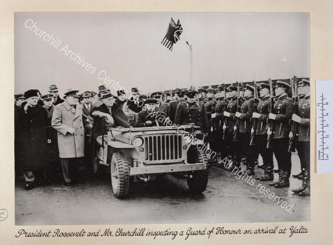 Photo shows WSC and Roosevelt accompanied by a large group of people including Soviet Foreign Minister Vyacheslav Molotov (wearing a dark greatcoat