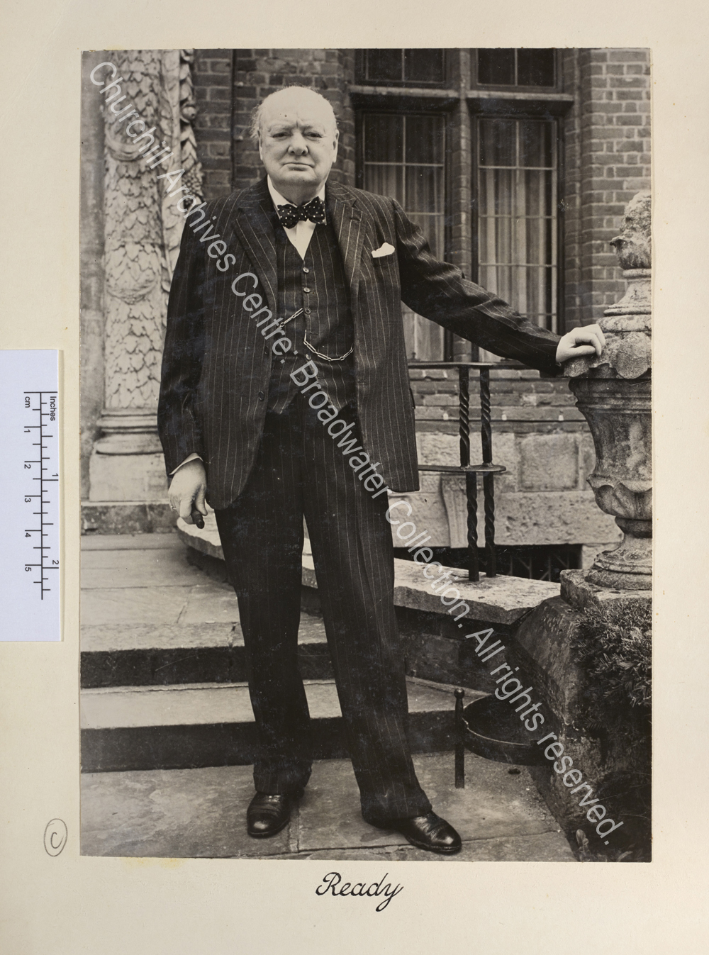 Photo of WSC standing outside the front entrance of Chartwell. He is looking straight to camera