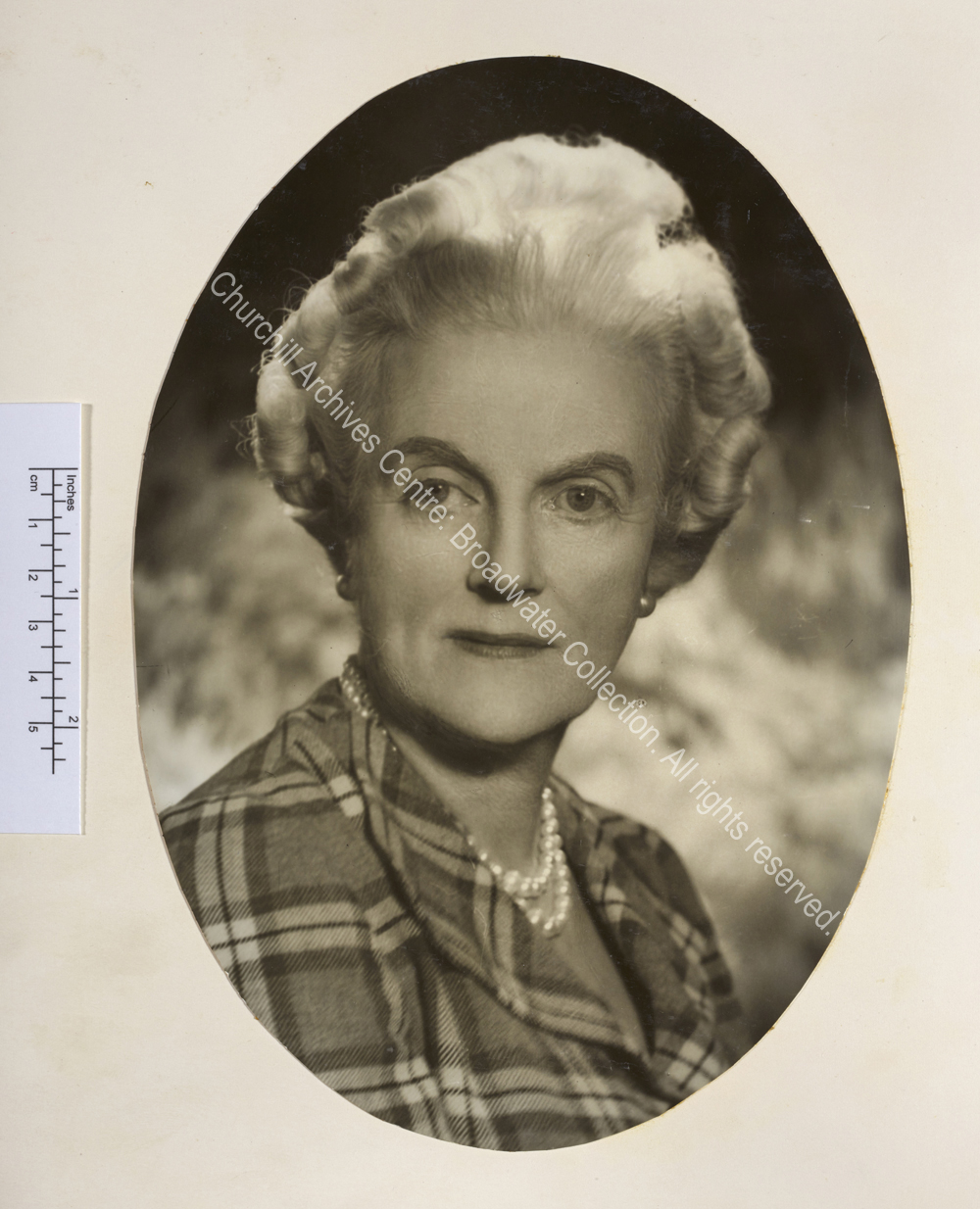 Oval portrait photograph of CSC wearing pearl earrings and necklace and a blouse with a tartan pattern. Possibly by Vivienne [Mrs Florence Entwistle also known as Florence Vivienne Mellish].
