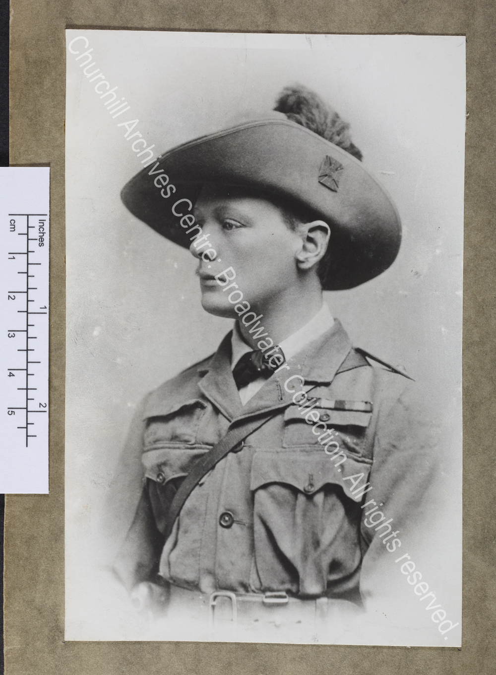 Head and shoulders photograph of WSC in profile (facing left)
