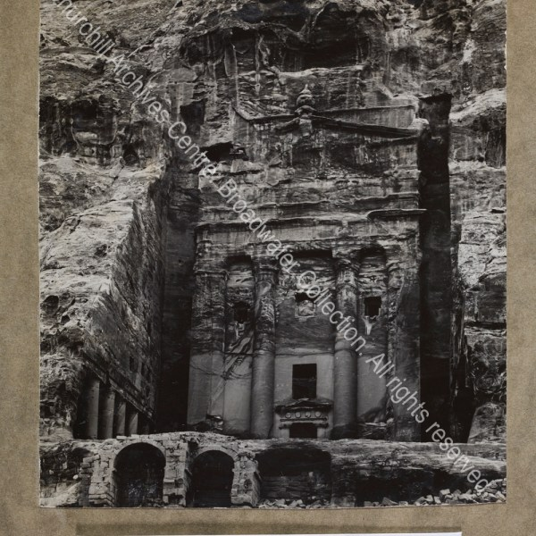Photograph of a building carved into rock at [Jordan]
