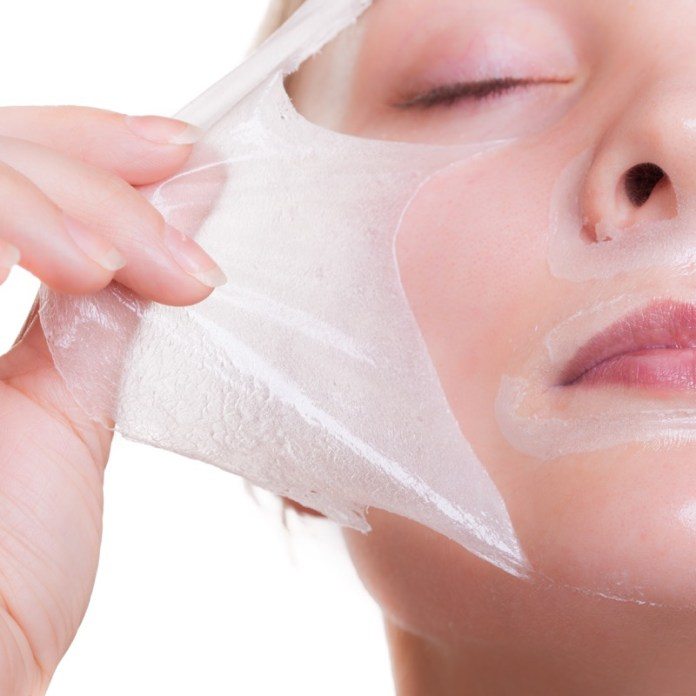 Portrait blond girl in facial mask. Part face. Beauty and skin care.