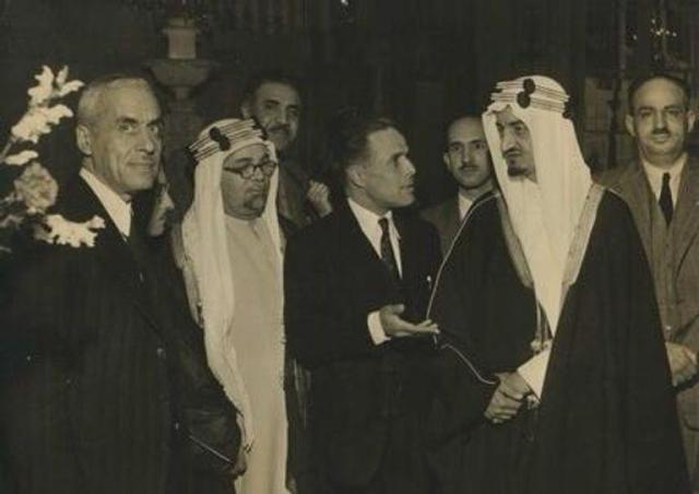 What do you know about the stages of development of the Saudi flag and its designer, who was saved by the Kingdom?