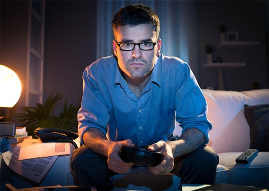 Image result for person playing PlayStation