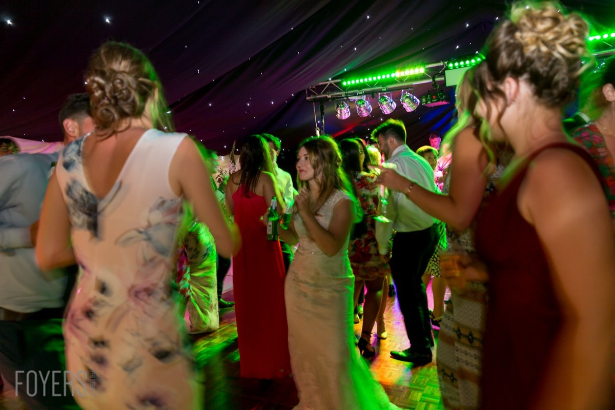 Bride and friend dancing to The brilliant Lee Vasey Band played throughout the night