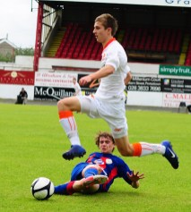 Co.Armagh's Jamie Rae skips past the tackle from KSCA Moscow. County Armagh 2 KSCA Moscow 2 Milk Cup Junior Tournament, Shamrock Park, Portadown, N.Ireland 21/07/2012 CREDIT: LiamMcArdle.com