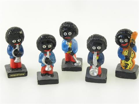 A ROBERTSONS PAINTED COMPOSITION GOLLIWOG BAND OF FIVE FIGURES