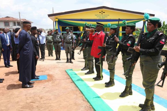 Vice President Prof. Yemi Osinbajo SAN and His Excellency, Governor of Ondo State, Dr. Olusegun Mimiko ready to inspect a guard of honour mounted by The Nigeria Police Force at the New Police Divisional Headquarters Ilara-Mokin. Friday July 8, 2016