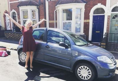 Blogger Bethany Wash with her car