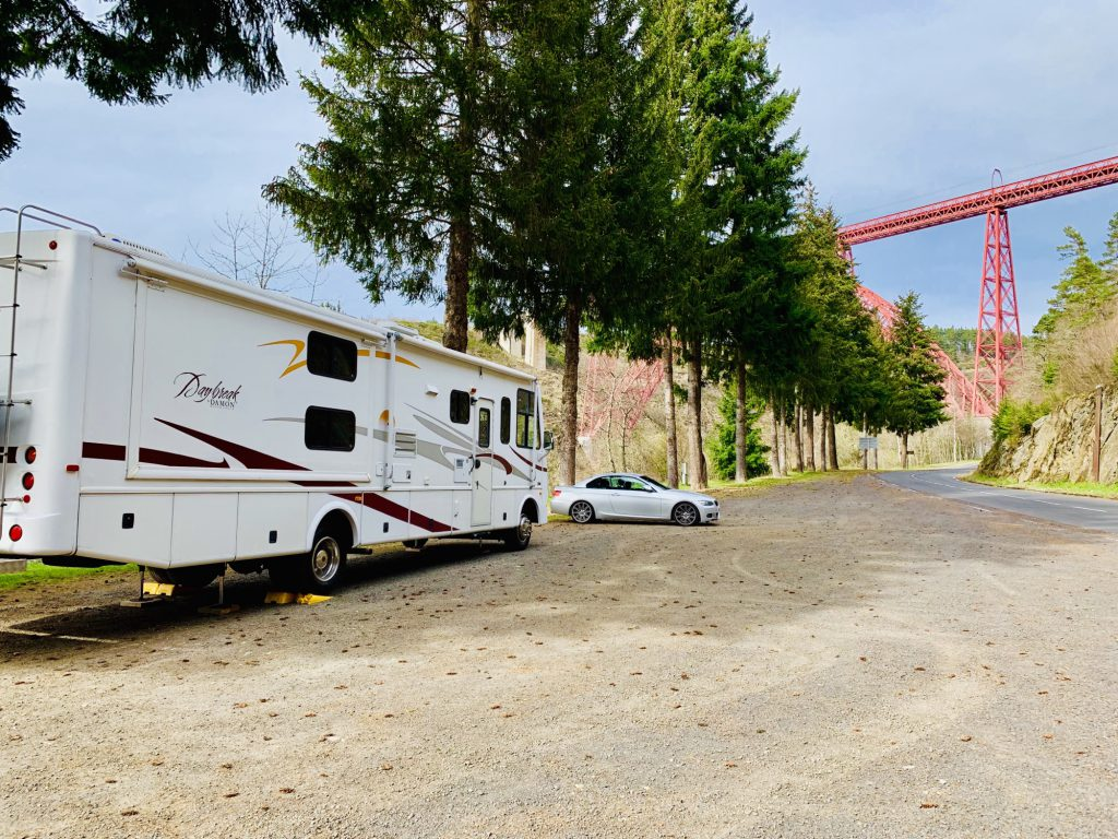 The RV and the BMW parked below the Garabit Viaduct