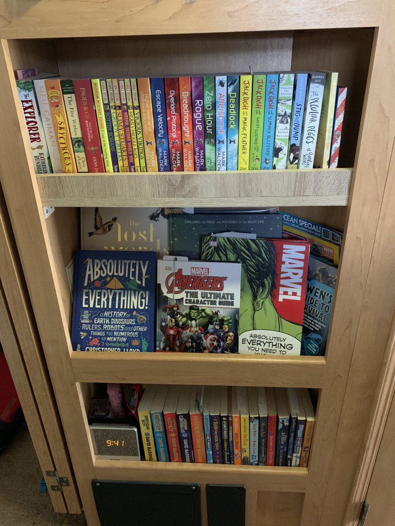 A cubbyhole in the RV has now got three shelves, all holding childrens books and a digital clock