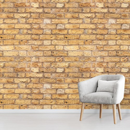 Yellow Brick Effect Wallpaper mural design in situ with comfy grey chair
