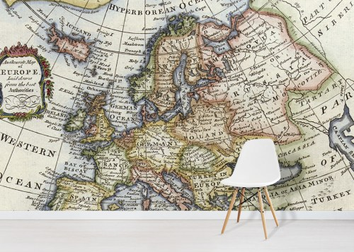 Vintage Map Of Europe Wall Mural in situ with white chair