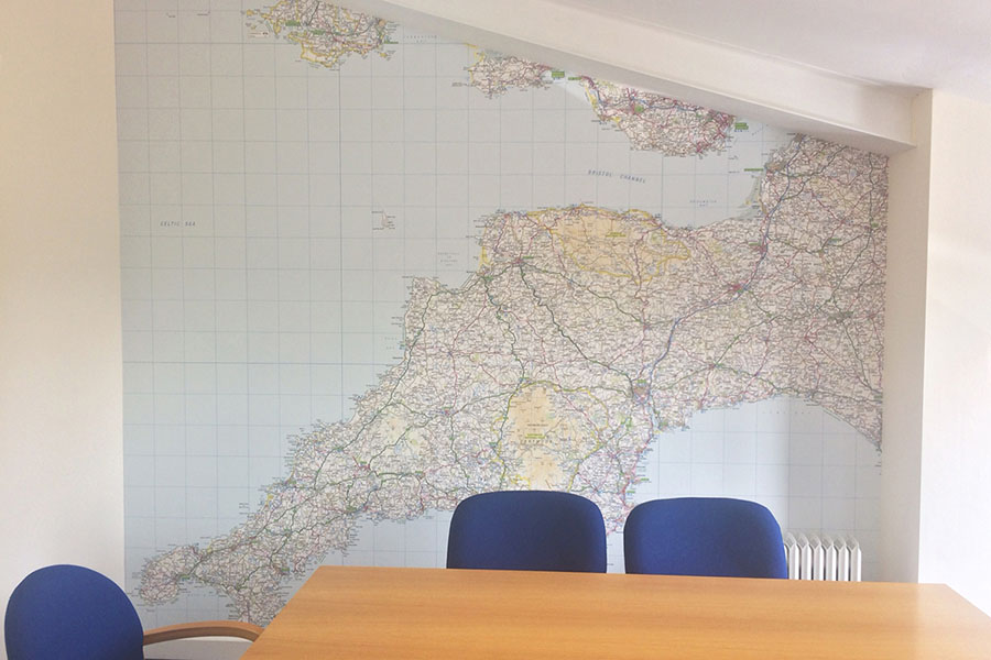 Regional Ordnance Survey map wallpaper mural in meeting room with blue chairs
