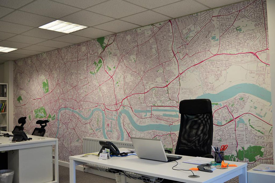 Colourful custom map of London wallpaper in office space with desk and chair