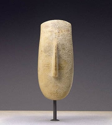 A marble head of the Cycladic. This piece was sold by Ed Merrin to the J. Paul Getty Museum.