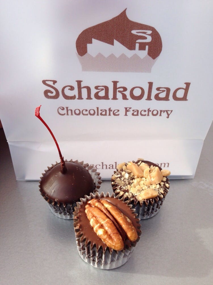 Schakolad Chocolate Factory - Fort Worth, TX, United States. Top left to right to bottom: Dark Chocolate Cherry, Dark Chocolate Toffee Crunch, and Milk Chocolate Pecan