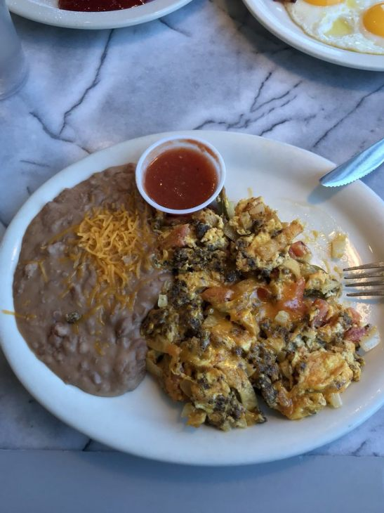 Photo of Angela's Cafe - Dallas, TX, United States. Migas with chorizo and refried beans