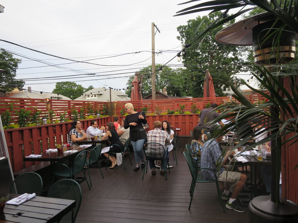 Libertad - Skokie, IL, United States. Rear patio view, on a pleasant summer evening.