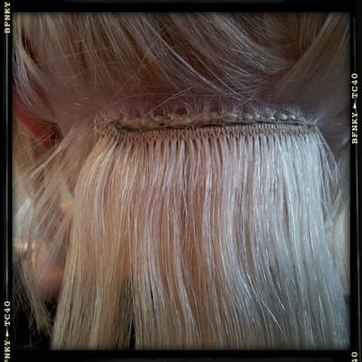 first line of sewn in hair extensions hair is plaited and hair extensions in a weft is then sew
