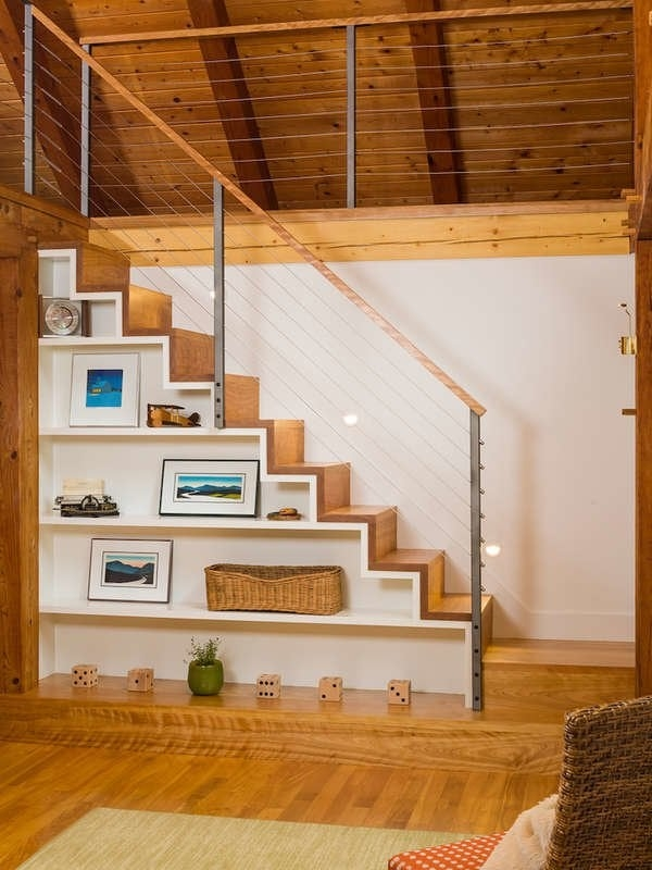 Under Stair Storage 17 Clever Ideas Bob Vila   Open Concept With Basement Stairs In Middle Of House   Dining Room   Basement Steps   Basement Remodeling   Stair Case   Kitchen