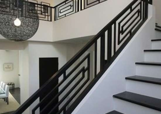 Staircase Railing 14 Ideas To Elevate Your Home Design Bob Vila | Modern Wood Staircase Railing | Residential | Interior | Floor To Ceiling | Ultra Modern | Traditional Wood Stair