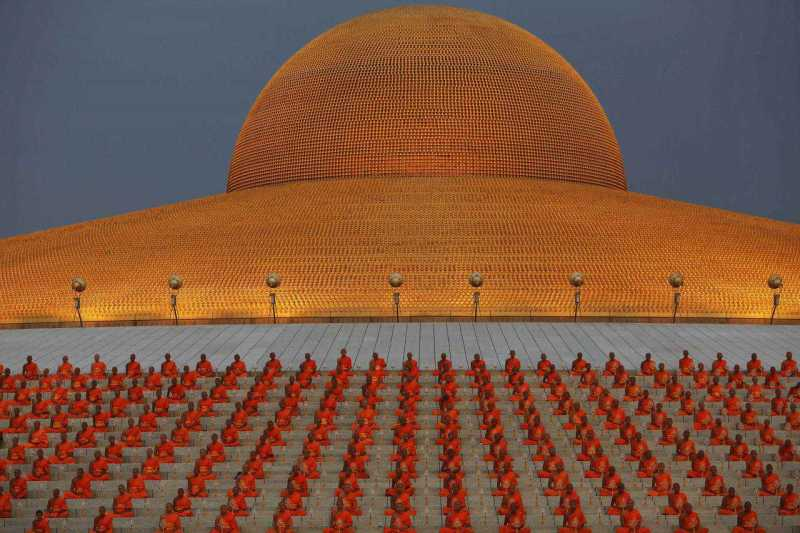 Buddhist monks pray at the Wat Phra Dhammakaya temple in Pathum Thani province, north of Bangkok on Makha Bucha Day