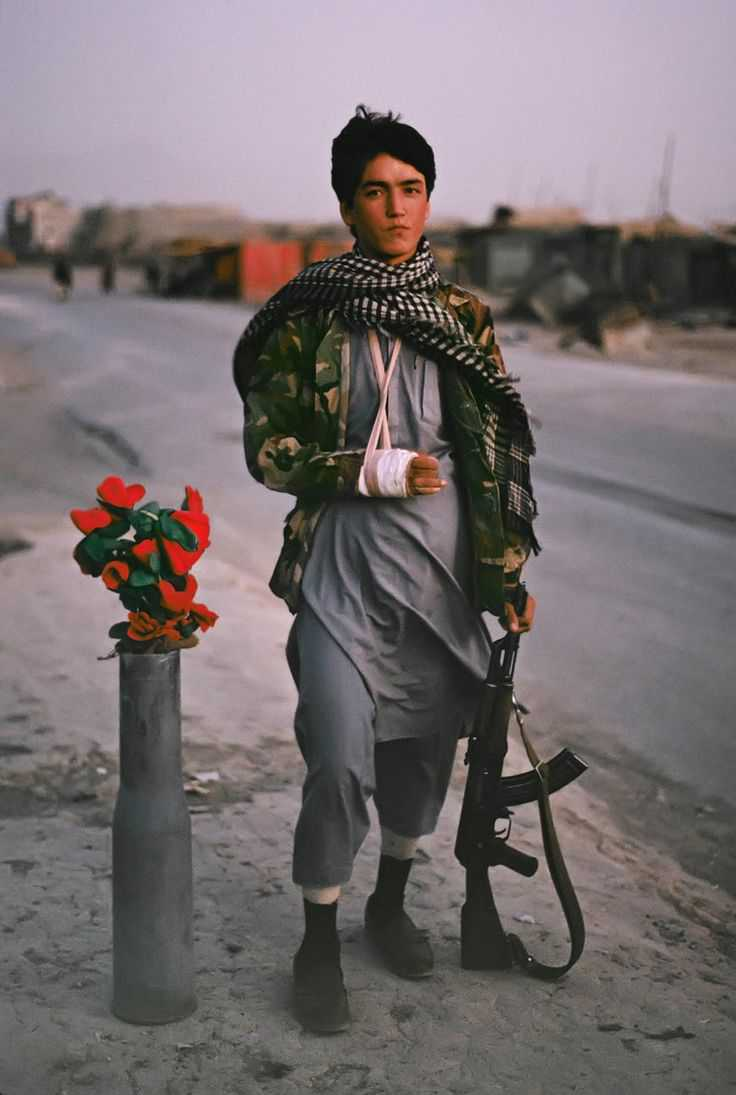 AFGHANISTAN. Kabul. 1992. A Shia Muslim fighter from Hazara guards a checkpoint.