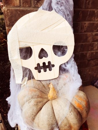 Make your front porch Halloween ready with this cute mummy skull hanging for less than $10! Personalize it to your style with just a few supplies.