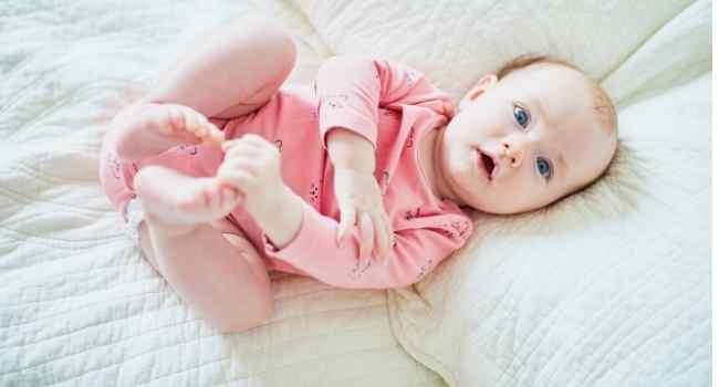 4 Month Old Baby Development & Milestones