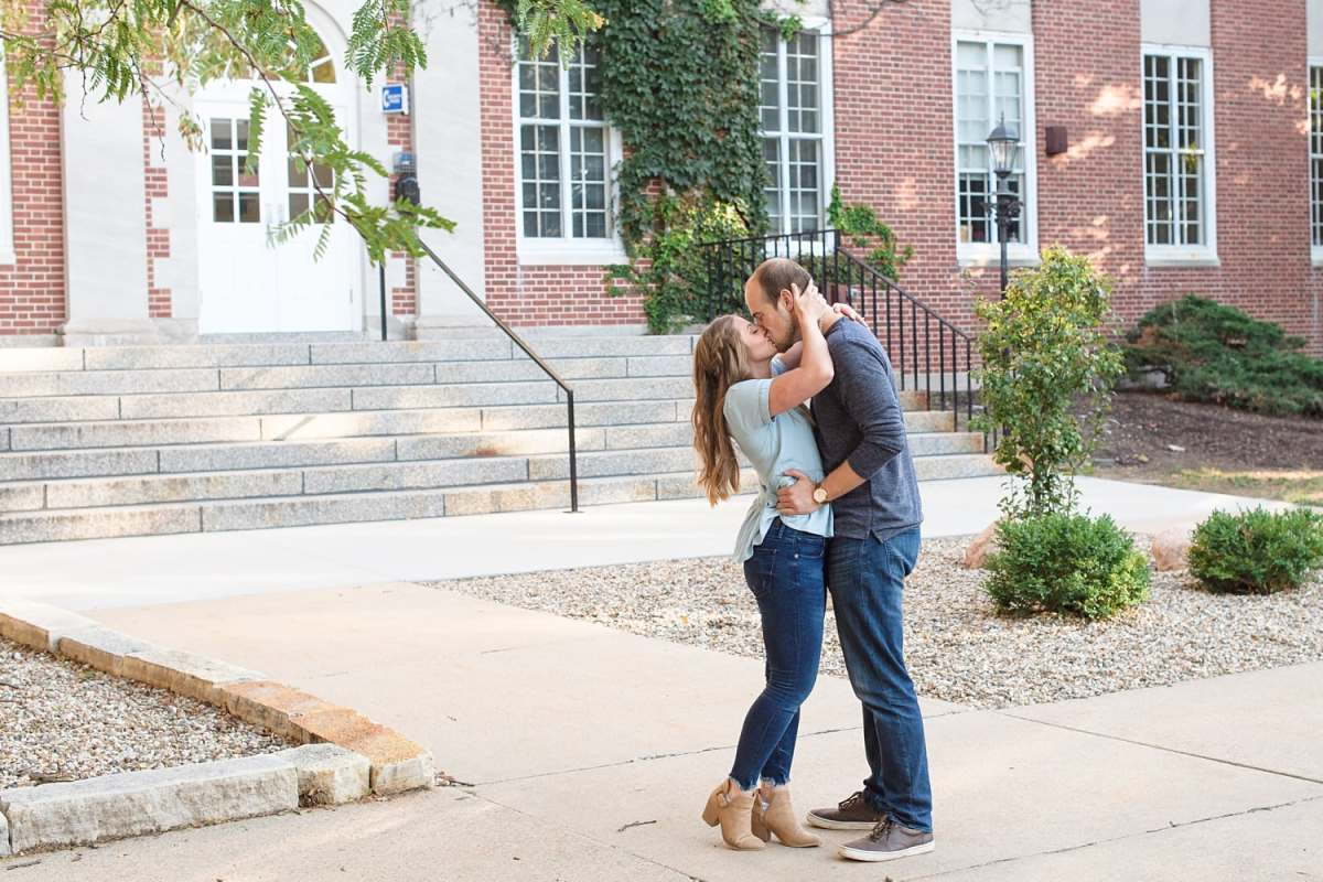 Engagement photos at Coe college in front of the library