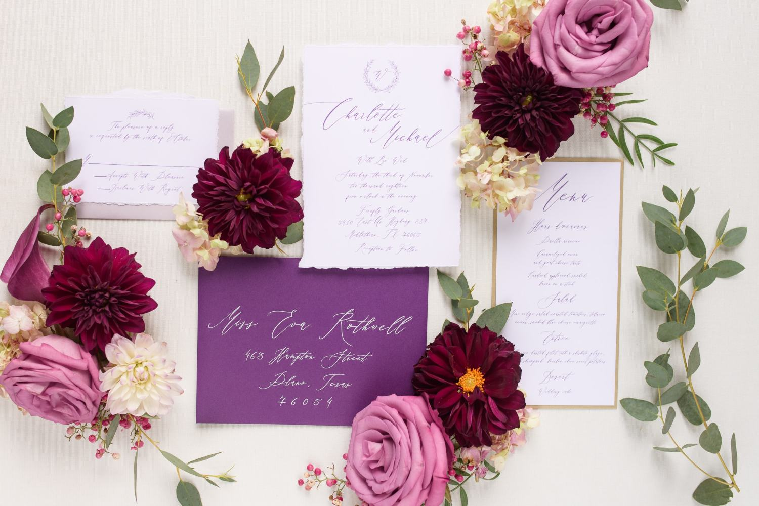 plum and purple wedding invitation flat lay detail