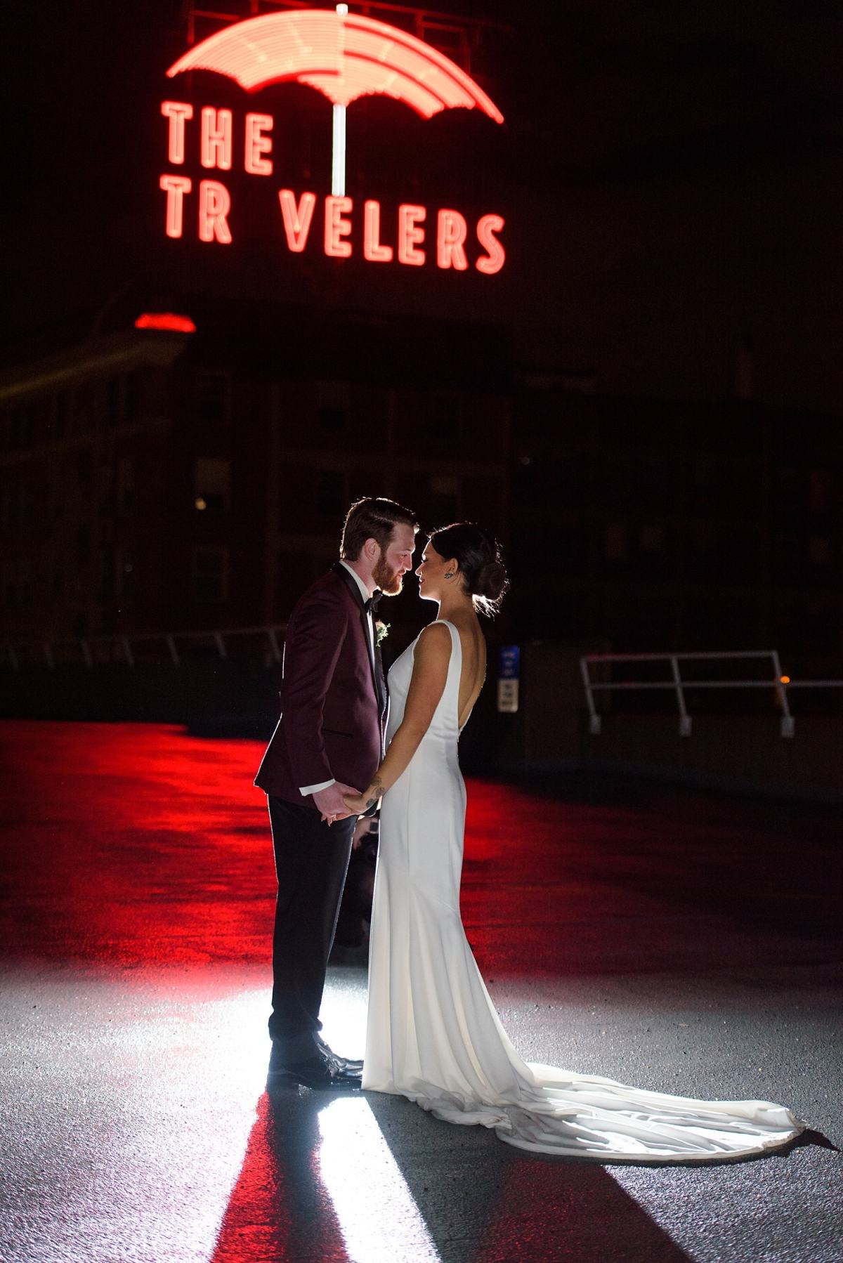 des moines travelers sign and bride and groom at night