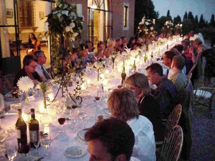 A Tuscan wedding long table dusk