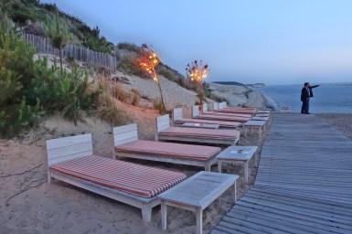 La Coorniche beach beds at dusk