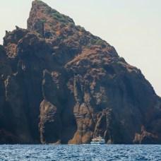 Scandola Nature Reserve boat against cliffs