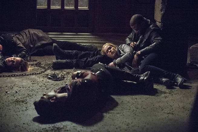 "Arrow -- ""My Name is Oliver Queen"" -- Image AR323A_0020b -- Pictured (L-R):  Katie Cassidy as Laurel Lance, Emily Bett Rickards as Felicity Smoak, and David Ramsey as John Diggle -- Photo: Cate Cameron/The CW -- © 2015 The CW Network, LLC. All Rights Reserved."
