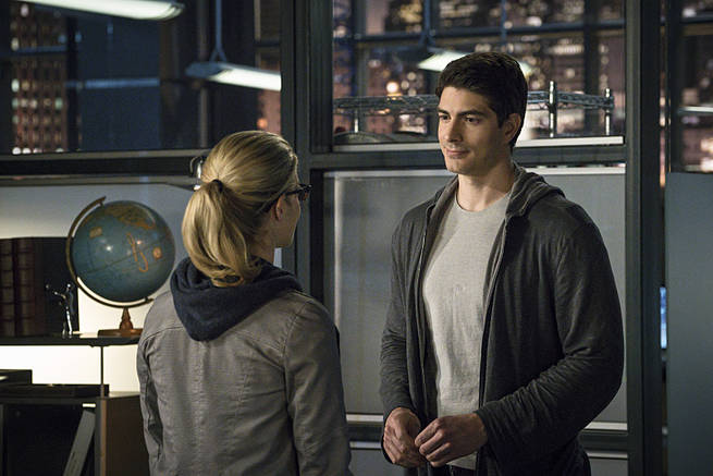 """Arrow -- """"My Name is Oliver Queen"""" -- Image AR323B_0290b -- Pictured (L-R): Emily Bett Rickards as Felicity Smoak and Brandon Routh as Ray Palmer  -- Photo: Liane Hentscher/The CW -- © 2015 The CW Network, LLC. All Rights Reserved."""