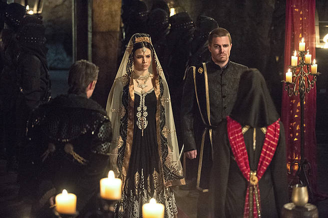 """Arrow -- """"This is Your Sword"""" -- Image AR322A_0243b -- Pictured (L-R): Katrina Law as Nyssa al Ghul and Stephen Amell as Oliver Queen -- Photo: Cate Cameron/The CW -- © 2015 The CW Network, LLC. All Rights Reserved."""